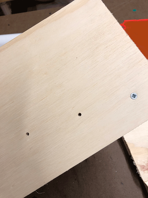 Cnc routed holes to guide the sheet metal screws to be aligned with the dowels